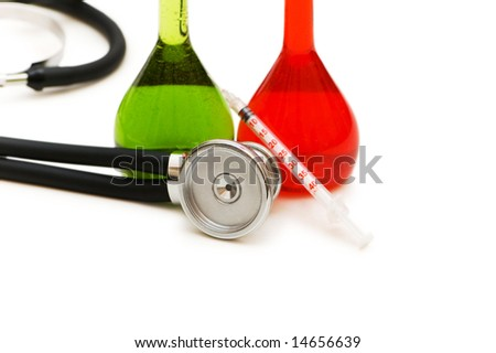 Tubes and stethoscope isolated on the white - stock photo