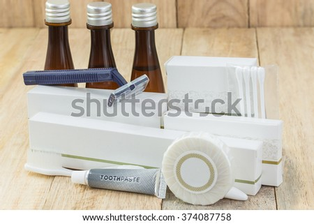Tubes of bathroom amenity contains on wooden background - stock photo