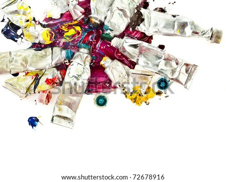 Tubes of colorful oil paint on white - stock photo