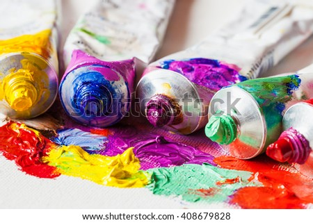 Tubes of oil paint closeup on artist palette with paints