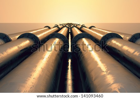 Tubes running in the direction of the setting sun. Pipeline transportation is most common way of transporting goods such as Oil, natural gas or water on long distances. - stock photo