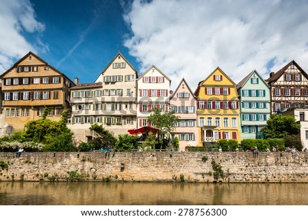 TUBINGEN, GERMANY - MAY 17,2015: A traditional punt is passing the beautiful waterfront of Tubingen (Tuebingen) in the south of Germany. Tubingen is a very lively university town about 30 kilometres - stock photo