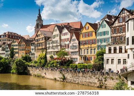 TUBINGEN, GERMANY - MAY 17,2015: A traditional punt is passing the beautiful waterfront of Tubingen (Tuebingen) in the south of Germany. Tubingen is a very lively university town about 30 kilometres