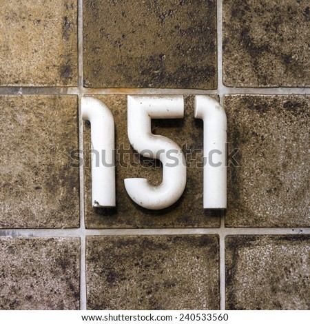 tubular house number one hundred and fifty one - stock photo