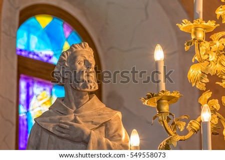 TUCEPI, CROATIA - September 21, 2016: Saint Francis statue, part of the interior of the Church of St. Anthony in old village in Dalmatia.