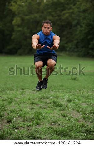 Tuck jump - stock photo