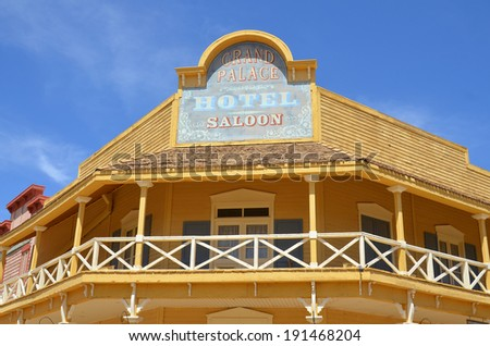 TUCSON ARIZONA APRIL 24: A vintage saloon at Old Tucson on april 24 2014 in Tucson Arizona. A Western saloon is a kind of bar particular to the Old West. - stock photo