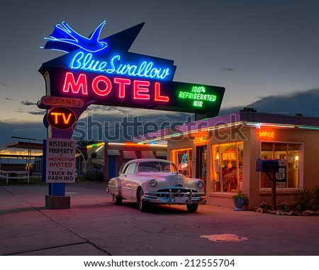 TUCUMCARI, NEW MEXICO - AUGUST 8: Historic Blue Swallow Motel on Tucumcari Boulevard (Route 66) on August 8, 2014 in Tucumcari, New Mexico - stock photo