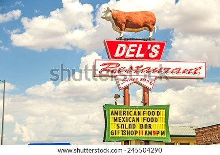 TUCUMCARI, NEW MEXICO - AUGUST 25, 2013: Photo of the Del's Restaurant sign which has been in operation on Route 66 since 1956. - stock photo