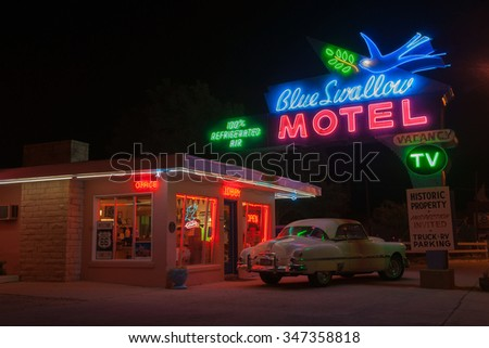 TUCUMCARI,USA - SEPTEMBER 14: Blue Swallow Motel classic neon signs illuminated at night a landmark Route 66 motel dating from 1939 on September 14, 2015 Tucumcari, New Mexico, USA.