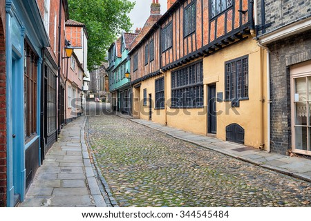 Tudor half timbered houses and cobbled streets at Norwich in Norfolk - stock photo