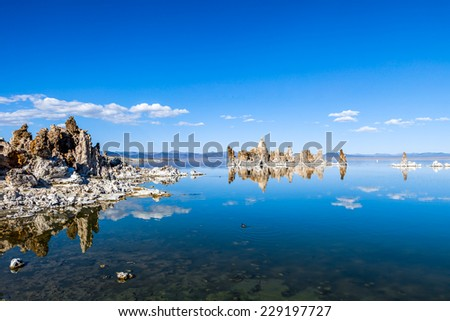 Tufa columns reflected in the mirrored water surface at Mono Lake, California