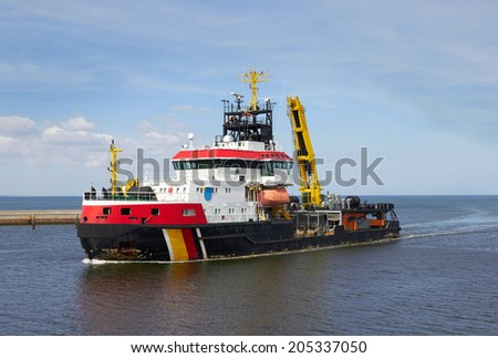 tug boat at an industrial harbor  - stock photo