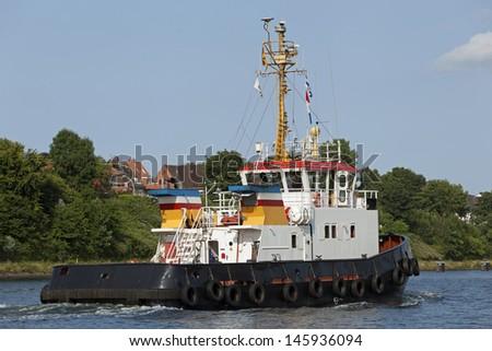 Tug boat on Kiel Canal, Germany - stock photo