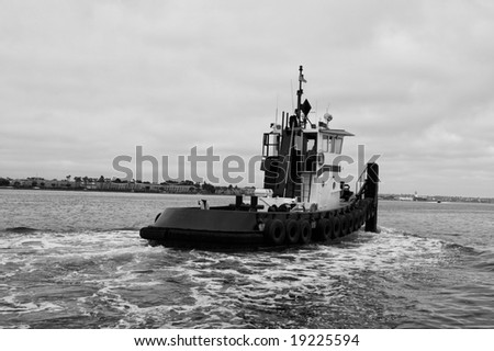 Tug Boat sailing in a harbor