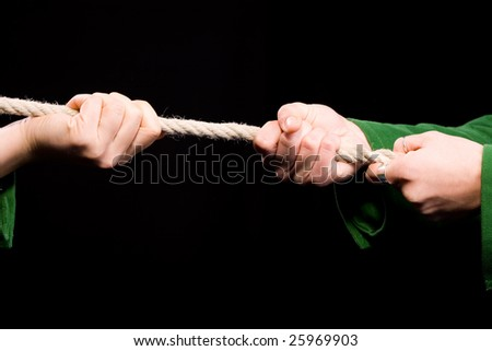 Tug of War cloese-up on hands. duel and challenge concept - stock photo