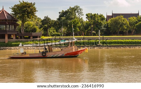 Tugboat pulling barge in Chaophraya river, Ayutthaya, Thailand - stock photo