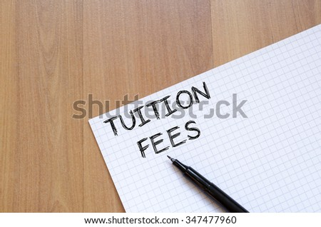 Tuition fees text concept write on notebook with pen