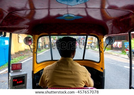 Tuk tuk driving trough streets of India. View from the interior of the rickshaw