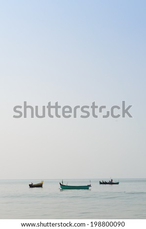 Tuktuk driving trough the streets of India - stock photo