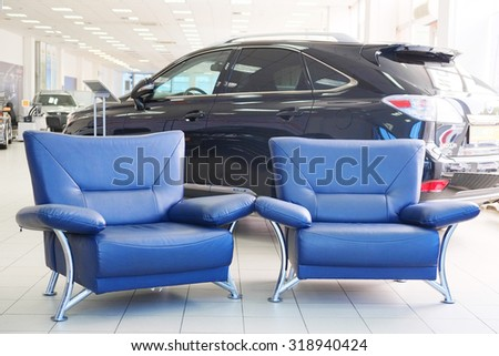 Tula, Rossia, September, 2, 2015: chairs in  client place of a second-hand cars dealer showroom. In the conditions of an economic crisis more and more buyers get cars in the secondary market in Russia - stock photo