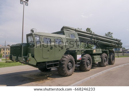 "TULA, RUSSIA - JUNE 4, 2015 : MLRS 9K58 ""Smerch"" - Soviet and Russian multiple launch rocket systems fire in the Tula city Weapon Museum, overlooking the rear wheels"