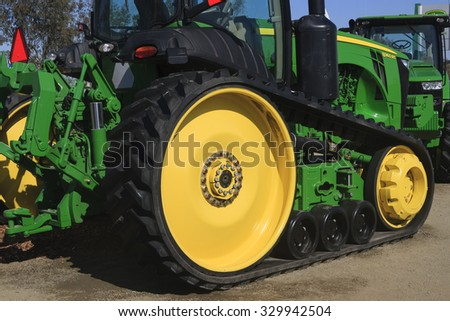 Tulare, CA - February 9, 2011: Wheels and tracks of a new John Deer tractor - stock photo