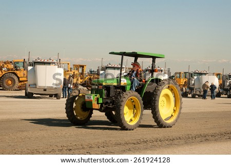 Tulare, CA, USA - February 11, 2011: A John Deere tractor at a California agricultural equipment auction. - stock photo