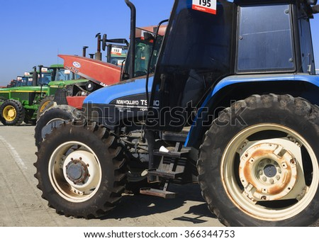 Tulare, CA, USA - February 11, 2011: Farm tractors lined up at an agricultural auction in California.