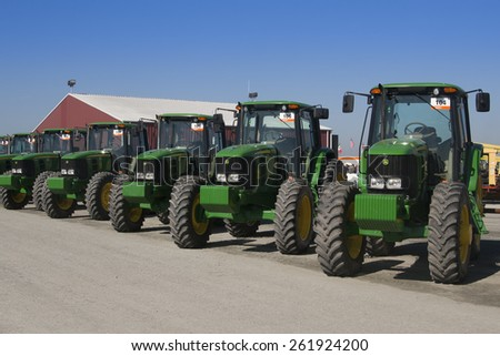 Tulare, CA, USA - February 11, 2011: John Deere tractors lined up at a California agricultural auction. - stock photo