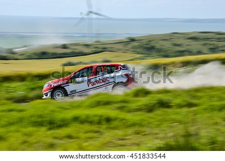 TULCEA, ROMANIA - JUNE 10, 2016: Competitors in Danube Delta Rally stage in National Rally Championship & FIA European Rally Trophy