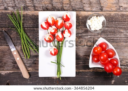tulip creative with tomato and cheese for easter - stock photo