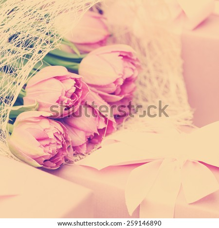 Tulip Flowers and Gift. Pink Floral Background - stock photo