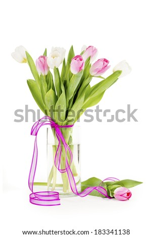 Tulip flowers in a vase isolated on white with clipping path - stock photo