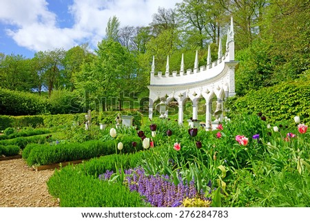 Tulips and a beautiful Spring late afternoon looking towards The Exedra in Rococo Gardens, Painswick, The Cotswolds, Gloucestershire, United Kingdom