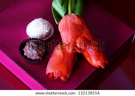 Tulips and candy and gift box - stock photo