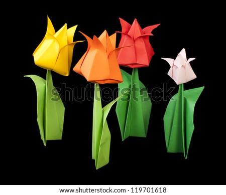 Tulips isolated on black background. Paper made flowers. - stock photo