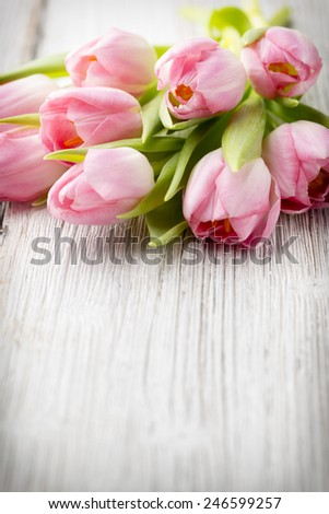 Tulips on a wooden surface. Studio photography.