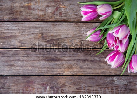 tulips on wooden table - stock photo