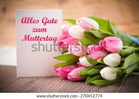 """tulips with message saying """"Best wishes for Mother's Day"""" in German - stock photo"""