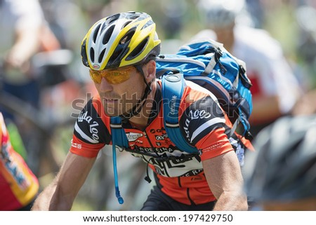 TULLINGE, STOCKHOLM - JUNE 8: Closeup of a focused rider in after the start in the Lidaloop mountainbike race 2014 during a sunny day in the Swedish nature. June 8, 2014 in Stockholm, Sweden.