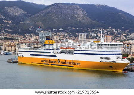 "TULON, FRANCE, MAY 19, 2014: Luxury passenger ship Mega Express, company ""Corsica Sardinia Ferries  Olympia  moored in the harbour in Tulon  on a rainy day. - stock photo"