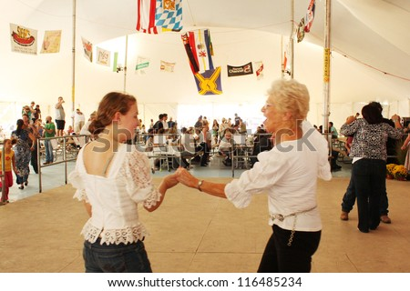 TULSA, OK - OCT 20: Oktoberfest goers enjoy dancing at Oktoberfest in TULSA, OK, on October 20, 2012 in TULSA, OK. Tulsa is the origin of the first Oktoberfest Chicken Dance in the United States. - stock photo