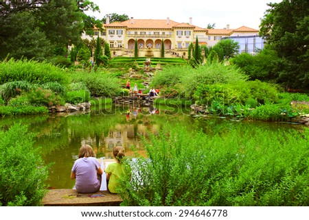 TULSA, OKLAHOMA - JUNE 13, 2015: People Enjoy A Day in a park at the Philbrook Museum of Art in Tulsa, Oklahoma. Museum draws a large crowd every second Saturday of the month, when admission is free. - stock photo