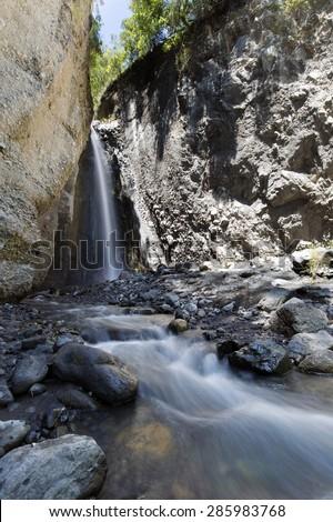 Tululusia Falls at Mount Meru near Arusha in Tanzania. Africa. Mt Meru is located 60 kilometres west of Mount Kilimanjaro. - stock photo