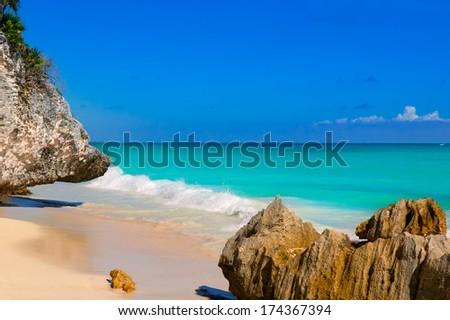 Tulum beach near Cancun turquoise Caribbean water and blue Sky - stock photo