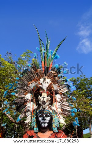 TULUM, MEXICO - JANUARY 25, 2011: Mayan unidentified warrior with traditional costume and feather masks in a traditional ritual dance, Tulum, Mexico, January 25, 2011. - stock photo