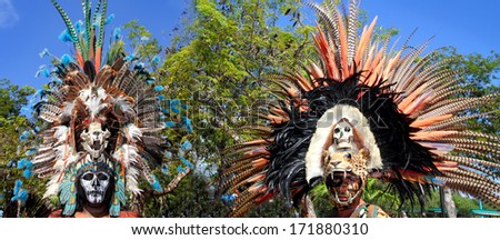 TULUM, MEXICO - JANUARY 25, 2011: Mayan unidentified warriors with traditional costume and feather masks in a traditional ritual dance, Tulum, Mexico, January 25, 2011. - stock photo