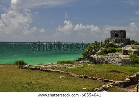 Tulum ruins with turquise water - stock photo