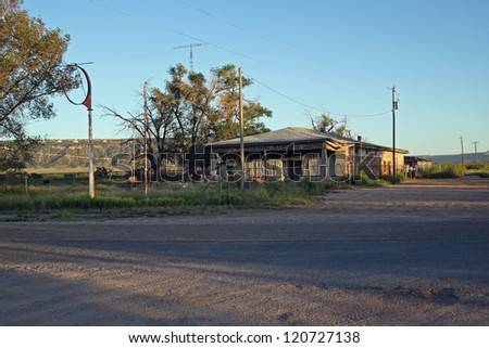 Tumble-down gas station - an old gasoline station, missing the sign, sits on the eastern plains of New Mexico - stock photo